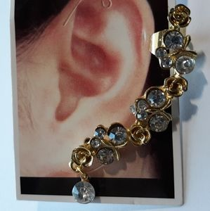 Goldtone cuff earring with clear stones and roses